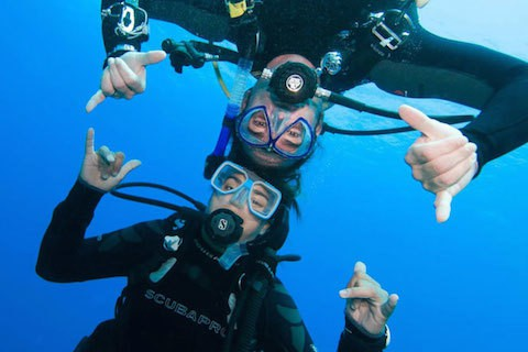 Divers having fun on their free or paid divemaster internship